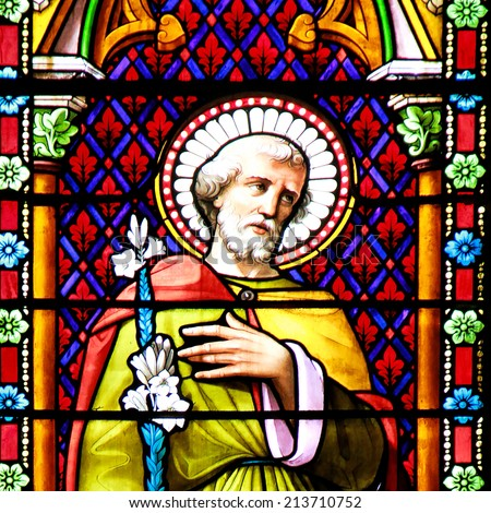 MEZE, FRANCE - July 23, 2014: Apostle. Stained glass window in the Cathedral of Meze, South of France on July 23, 2014 - stock photo
