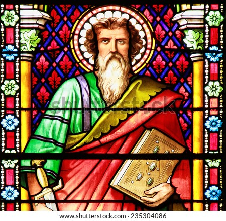 MEZE, FRANCE - July 23, 2014: Apostle. Stained glass window in the Cathedral of Meze, South of France - stock photo
