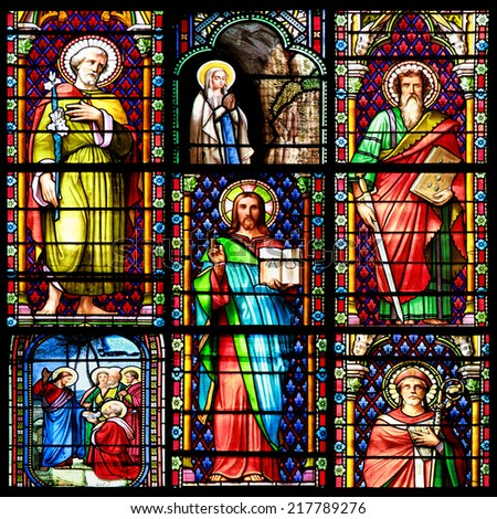 MEZE, FRANCE - July 23, 2014: Photo collage of Scenes of the Bible. Stained glass window in the Cathedral of Meze, on July 23, 2014 in Meze, south of France - stock photo