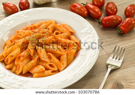 Mezze penne dressed with tomato sauce, garlic and oregano - Mediterranean diet
