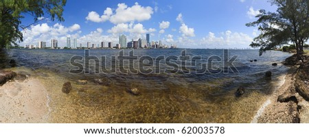 Miami and Biscayne Bay Skyline Panorama from Rickenbacker Causeway - stock photo