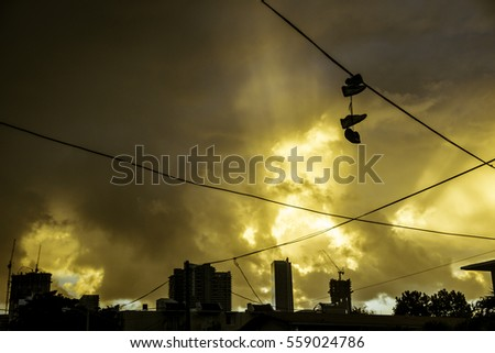 Miami at Sunrise with Shoes hanging from power lines.