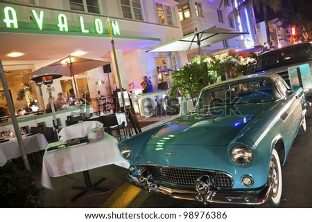 MIAMI BEACH, FL - DECEMBER 29: First generation (1955-1957) Ford Thunderbird parked in front of the restaurant in Hotel Avalon in Miami Beach, Florida.  on December 29, 2011. - stock photo