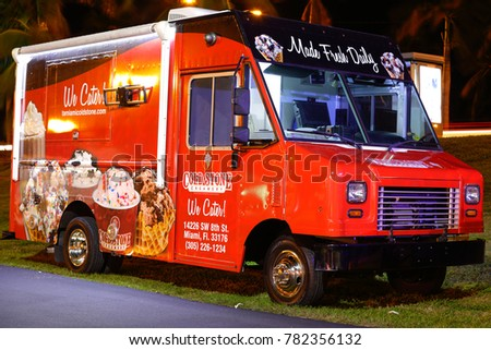 MIAMI BEACH, FL, USA - DECEMBER 26, 2017: Night photo of food trucks in Haulover Park held every Tuesday night