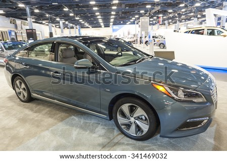 MIAMI BEACH, FL, USA - NOVEMBER 6, 2015: Hyundai Sonata hybrid on display during the 2015 Miami International Auto Show at the Miami Beach Convention Center in downtown Miami Beach. - stock photo