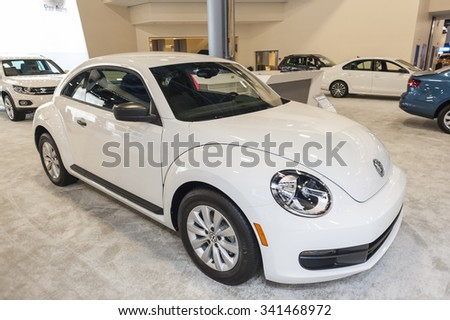 MIAMI BEACH, FL, USA - NOVEMBER 6, 2015: Volkswagen Beetle on display during the 2015 Miami International Auto Show at the Miami Beach Convention Center in downtown Miami Beach.