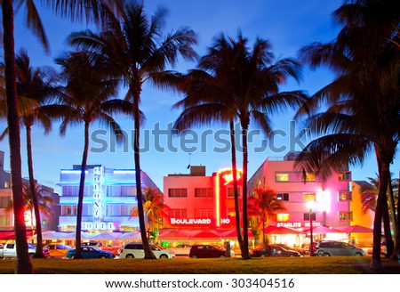 Miami Beach, Florida USA-April 5, 2013:Illuminated hotels and restaurants at sunset on Ocean Drive, world famous destination for nightlife, beautiful weather and pristine beaches - stock photo