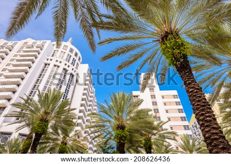 Miami Beach, Florida USA - August 1, 2014: Beautiful Miami Beach, a popular international travel destination, cityscape with palm trees and art deco architecture. - stock photo