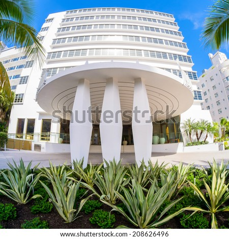 Miami Beach, Florida USA - August 1, 2014: The beautiful Shelborne Club Hotel in Miami Beach, a popular international travel destination, fish eye view with palm trees and art deco architecture. - stock photo