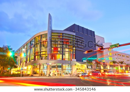 Miami Beach, Florida USA-November 13, 2015: Lincoln Road Mall Movie Theater and moving traffic at sunset, beautiful colorful architecture in the famous tourist destination of Miami Beach - stock photo