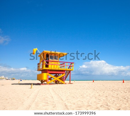 Miami Beach Florida, yellow Art deco lifeguard house on a beautiful summer day with blue sky in the background - stock photo