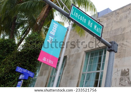 MIAMI BEACH - NOVEMBER 21, 2014: Image of Art Basel signage on Lincoln Road Miami Beach. Art Basel is an annual art trade show which occurs in Miami every December 4-7.  - stock photo