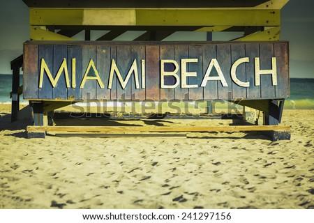 Miami Beach sign on wood background, South Beach, Florida - stock photo