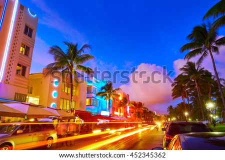 Miami Beach South Beach sunset in Ocean Drive Florida Art Deco and car lights