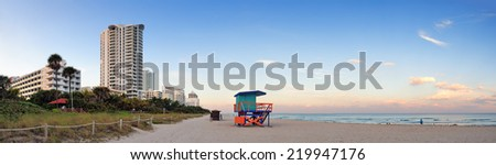 Miami Beach sunset panorama with lifeguard tower and hotels. - stock photo