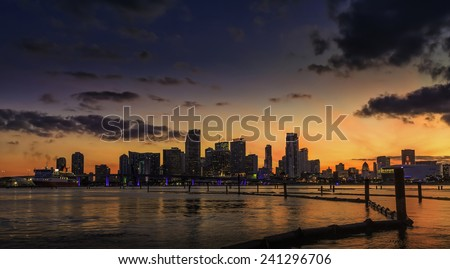 Miami city skyline at dusk with urban skyscrapers with reflection, Florida - stock photo