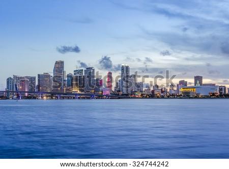Miami city skyline panorama at dusk with urban skyscrapers and bridge - stock photo