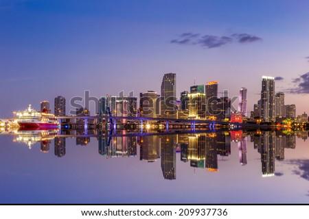 Miami city skyline panorama at twilight with urban skyscrapers and bridge - stock photo
