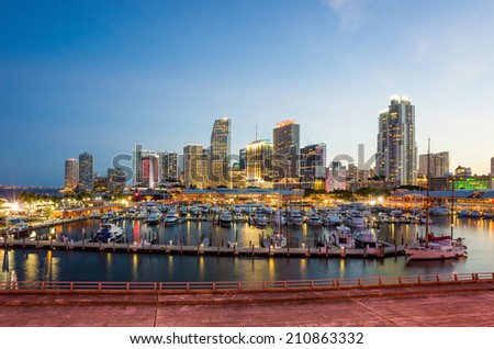 Miami city skyline panorama at twilight with urban skyscrapers, marina and bridge - stock photo