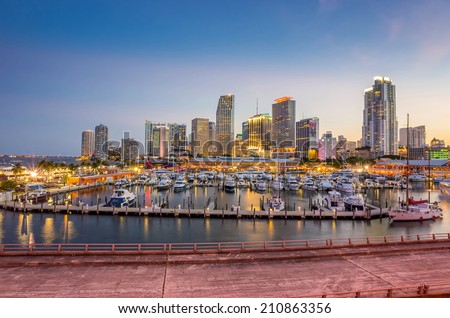 Miami city skyline panorama at twilight with urban skyscrapers, marina and bridge - stock photo