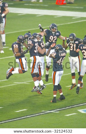 MIAMI - FEB 4: Members of the Chicago Bears jump on the field before playing Super Bowl XLI against the Indianapolis Colts at Dolphins Stadium on February 4, 2007 in Miami, Florida. - stock photo