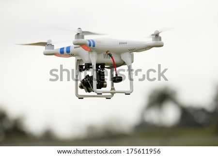 MIAMI - FEBRUARY 09: Photo of a Dji Phantom with gopro in flight taking aerial photos February 09, 2014 in Miami, USA. DJI Industries produces unmanned aircraft for surveillance - stock photo