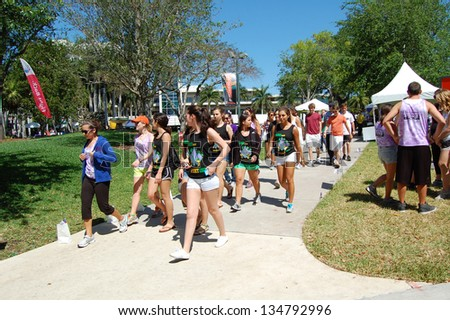 MIAMI, FL - APRIL 6: Students participate in the American Cancer Society Relay for Life event on the University of Miami campus in Coral Gables, Florida on April 6, 2013. - stock photo