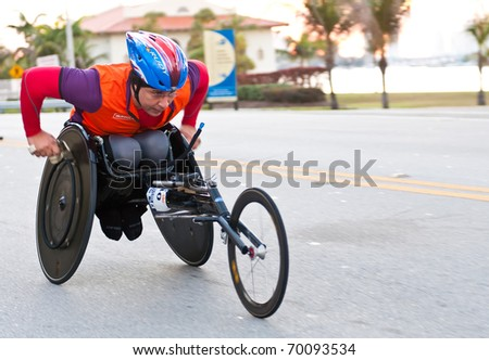 MIAMI, FL - JANUARY 30: An unidentified competitor racing in a wheelchair during the Miami Marathon on January 30, 2011 in Miami, Florida. - stock photo