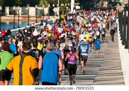 MIAMI, FL - JANUARY 30: Hundreds of competitors enter into one of cheering zones during the Miami Marathon on January 30, 2011 in Miami, Florida. - stock photo