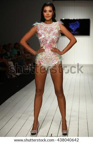 MIAMI, FL - JULY 16: A model walks runway in designer swim apparel during the Furne Amato fashion show for Miami Swim Week on July 16, 2015 - stock photo