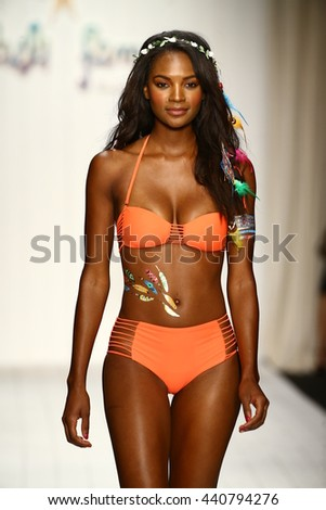 MIAMI, FL - JULY 18: A model walks runway in designer swim apparel during the Luli Fama Swimwear fashion show at Funkshion tent for Miami Swim Week on July 18, 2015