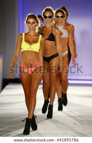 MIAMI, FL - JULY 19: Models walk runway finale in designer swim apparel during the Indah Swimwear fashion show at W hotel for Miami Swim Week on July 19, 2015