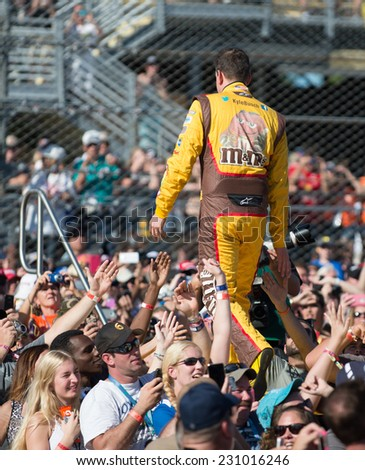 MIAMI, FL - Nov 16: Kyle Busch at the Nascar Sprint Cup Ford Ecoboost 400 race at Homestead-Miami Raceway in Homestead, FL on November 16, 2014 - stock photo
