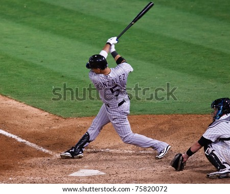 MIAMI, FL USA - APR. 22: Marlin first baseman Gaby Sanchez rounds the bases after hitting a home run in the third inning of the Colorado Rockies vs. Florida Marlins game April 22, 2011 in Miami, FL. - stock photo