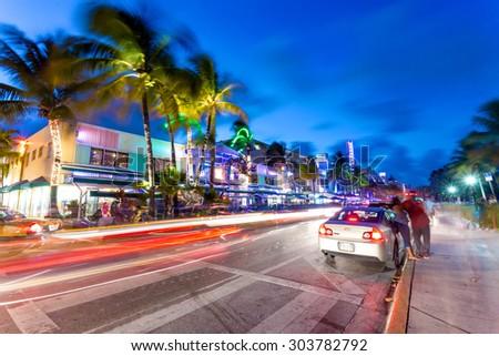 MIAMI, FL, USA, JUNE 12th, 2015. Ocean Drive scene at night lights, cars and people having fun, Miami beach. La noche de Ocean Drive en Miami Beach, Florida, Estados Unidos. - stock photo