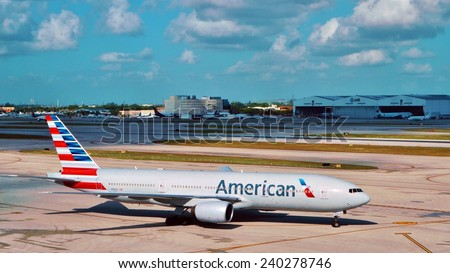 MIAMI, FLORIDA --DECEMBER 2013-- A Boeing 777 from American Airlines gets ready for takeoff at the Miami International Airport (MIA). - stock photo