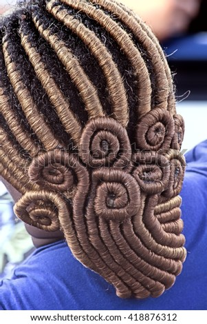 Miami, FLORIDA â?? November 7, 2015: Close up of a complex braided hairstyle of an African American woman
