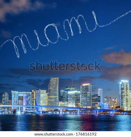 Miami Florida, summer sunset panorama with colorful illuminated business and residential buildings and bridge on Biscayne Bay  - stock photo
