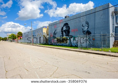 Miami, Florida USA - October 4, 2015: The  urban Wynwood area in midtown has become a popular tourist destination for the colorful graffiti art on the facades of commercial warehouse style buildings. - stock photo