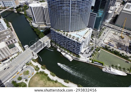 MIAMI - JULY 1: Aerial photo of the Miami River and the Brickell Bridge July 1, 2015 in Miami FL. Miami River is a canal that stems from the Florida Everglades nd heads out to the Atlantic Ocean.  - stock photo