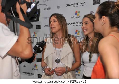 MIAMI - JULY 17: Designers Patrizia Simonelli (L) and Marcella Sant'Anna (R) backstage at the Cia Maritima Collection for S/S2012 during Mercedes-Benz Swim Fashion Week on July 17, 2011 in Miami, FL - stock photo