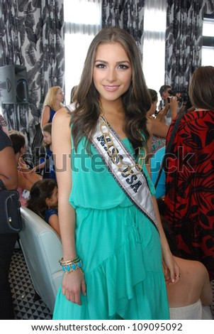 MIAMI - JULY 21: Miss USA Olivia Culpo at the Kooey Swimwear Presentation for Spring/ Summer 2013 during Mercedes-Benz Swim Fashion Week on July 21, 2012 in Miami, FL - stock photo