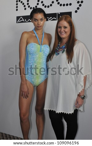 MIAMI - JULY 21: Model and Designer Nikki Silverthorne(R) at the Kooey Swimwear Presentation for S/S 2013 during Mercedes-Benz Swim Fashion Week on July 21, 2012 in Miami, FL - stock photo