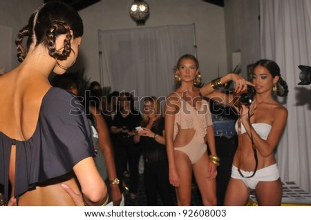 MIAMI - JULY 16: Model getting ready backstage at the Shay Todd Swimsuit Collection for Spring/ Summer 2012 during Mercedes-Benz Swim Fashion Week on July 16, 2011 in Miami, FL - stock photo