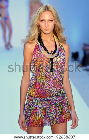 MIAMI - JULY 16: Model walking runway at the Dolores Cortes Swimsuit Collection for Spring/ Summer 2012 during Mercedes-Benz Swim Fashion Week on July 16, 2011 in Miami, FL - stock photo