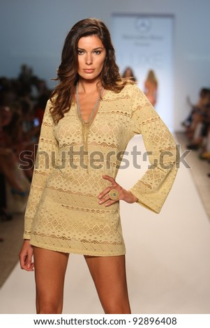 MIAMI - JULY 17: Model walking runway at the LUXE by Lisa Vogel Collection for Spring/ Summer 2012 during Mercedes-Benz Swim Fashion Week on July 17, 2011 in Miami, FL - stock photo