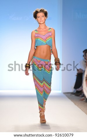 MIAMI - JULY 16: Model walks runway at the Mara Hoffman Swimsuit Collection for Spring/ Summer 2012 during Mercedes-Benz Swim Fashion Week on July 16, 2011 in Miami, FL - stock photo