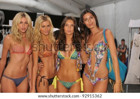 MIAMI - JULY 17: Models posing for house photographer backstage at the Cia Maritima Collection for S/S 2012 during Mercedes-Benz Swim Fashion Week on July 17, 2011 in Miami, FL - stock photo