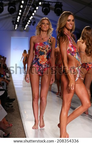 MIAMI - JULY 21: Models walk runway finale at Liliana Montoya Swim collection during MBFW Miami Swim at Cabana Grande on July 21, 2014 in Miami Beach Florida