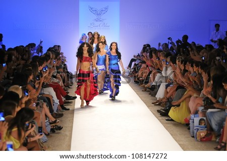 MIAMI - JULY 19: Models walk runway finale at the Lisa Blue Collection for Spring/ Summer 2013 during Mercedes-Benz Swim Fashion Week on July 19, 2012 in Miami, FL - stock photo